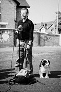 Gerry Posters - Gerry Adams at a street press conference in West Belfast with his dog and bottle of water Poster by Joe Fox
