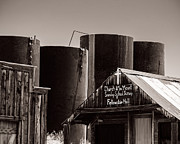 Abandoned Buildings Framed Prints - Ghost Town Church and Storage Tanks Framed Print by Royce Howland