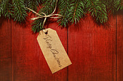Sandra Cunningham - Gift tag on red wood background