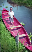 Africa Framed Prints - Girl and Fathers Canoe Framed Print by Muyiwa OSIFUYE