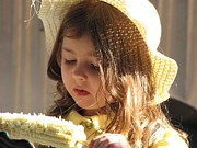 Featured Photos - Girl eating corn by Marianne Werner