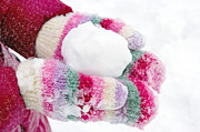 Hand-knitted Photos - Girl holding a snowball by Anna-Mari West