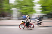 Holland Photos - Girl on Red Bicycle by Oscar Gutierrez