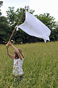 Raising Art - Girl raising the white flag in wheat field by Sami Sarkis