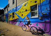 Eye Acrylic Prints - Girl Rides Bicycle Past Mural on the South Side of Pittsburgh Acrylic Print by Amy Cicconi