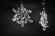 Christmas Symbols Prints - glass crystal snowflake pendants hanging on a christmas stall in Berlin Germany Print by Joe Fox