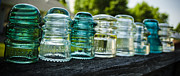 Collects Photo Framed Prints - Glass Insulator Row Framed Print by Deborah Smolinske