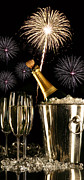 Bubbly Prints - Glasses of champagne with fireworks Print by Sandra Cunningham