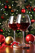 Glass Table Reflection Prints - Glasses of red wine in front of Christmas tree Print by Sandra Cunningham