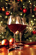 Glass Table Reflection Posters - Glasses of wine in front of Christmas tree Poster by Sandra Cunningham