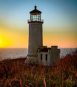 Lighthouse Sunset Prints - Glowing Lighthouse Print by Robert Bales
