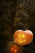 Jack O Lantern Photos - Glowing Pumpkin by Christopher and Amanda Elwell