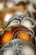 December Prints - Gold Christmas ornaments Print by Elena Elisseeva