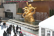 Skates Prints - Gold statue in Rockefeller Center Print by Geri Scull