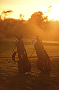 Golf Course Prints - Golf bags at sunset Print by Diane Diederich