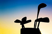 Professional Golf Posters - Golf equipment silhouette clubs at sunset Poster by Michal Bednarek