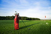Ball Field Posters - Golf gear on the golf field Poster by Michal Bednarek