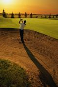 Golf Clubs Prints - Golfer Taking A Swing From A Golf Bunker Print by Darren Greenwood