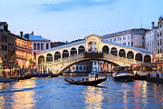 Vaporetto Posters - Gondola in front of Rialto bridge at dusk Venice Italy Poster by Matteo Colombo