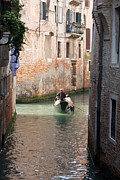 2009 Photo Prints - Gondolier in Venice Print by Gabriela Insuratelu