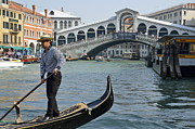 Tourist Destinations Framed Prints - Gondolier on gondola by Rialto bridge Framed Print by Sami Sarkis
