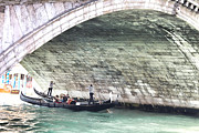 2009 Photo Prints - Gondolier under the Rialto Bridge Print by Gabriela Insuratelu