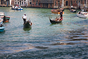2009 Photo Prints - Gondoliers on the Grand Canal Print by Gabriela Insuratelu