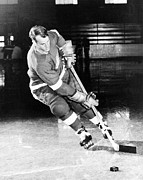 Hockey Photo Posters - Gordie Howe skating with the puck Poster by Sanely Great