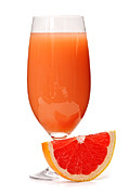 Sliced Photo Prints - Grapefruit juice in glass Print by Elena Elisseeva