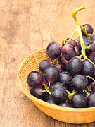 Food And Beverage Photo Metal Prints - Grapes Basket Metal Print by Wim Lanclus