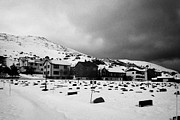 Honningsvag Prints - gravestones partially buried in the snow in the cemetery outside Honningsvag kirke church norway Print by Joe Fox