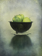Still Life Kitchen Posters - Green apples in an old enamel colander Poster by Priska Wettstein