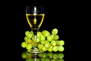 Grape Vine Photo Originals - Green grapes and a glass of white wine  by Tommy Hammarsten