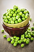 Dishes Posters - Green peas Poster by Elena Elisseeva