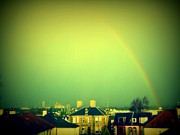 Urban Landscape Posters - Green Tinted Sky With Rainbow Poster by Mlle Marquee