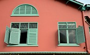 Window Bars Prints - Green window frames and shutters on earth red wall Print by Imran Ahmed