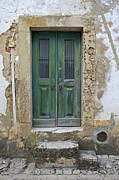 Pitted Photo Prints - Green Wood Door with Hand Carved Stone in the Medieval Village Of Obidos Print by David Letts