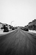 Winter Roads Framed Prints - gritted salted cleared road in a residential housing suburbian development Saskatoon Saskatchewan Ca Framed Print by Joe Fox