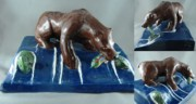 Fishing Ceramics - Grizzly with trout by Bob Dann