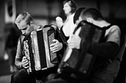 Buskers Photos - Group Of Accordion Players During Street Performance In Rynek Glowny Town Square Krakow by Joe Fox
