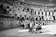 Ancient Rome Art - Groups Of Tourists And Guides In The Main Arena Of The Old Roman Colloseum At El Jem Tunisia by Joe Fox