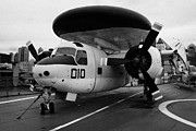 Manhaten Prints - Grumman E1B e1 Tracer on display on the flight deck of the USS Intrepid Print by Joe Fox