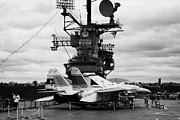 Manhatan Prints - Grumman F14 in front of the bridge on the flight deck of the USS Intrepid  Print by Joe Fox