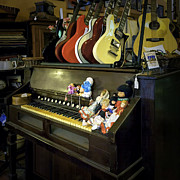 Toy Guitar Posters - Guitars and Dolls On An Old Organ Poster by Lynn Palmer