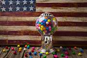 Candies Framed Prints - Gumball machine and old wooden flag Framed Print by Garry Gay