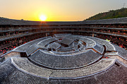 Sunlight. Circle Framed Prints - Hakka Tulou traditional Chinese housing at sunset Framed Print by Fototrav Print