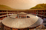 Sunlight. Circle Framed Prints - Hakka Tulou traditional Chinese housing at sunset Fujian China Framed Print by Fototrav Print