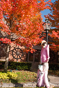 Hallloween Scarecrow And Red Maples In The Fall In Essex Village Connecticut Print by Robert Ford
