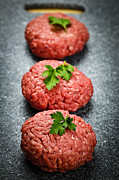 Uncooked Prints - Hamburger patties Print by Elena Elisseeva
