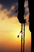 Rosary Photo Posters - Hand holding Rudraksha beads Poster by Tim Gainey